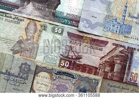 Arab Republic Of Egypt Currency Notes Background. Pounds And Piastres Cash Money Backdrop. Isolated