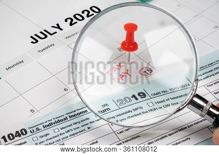The Tax Day Was Extended To July 15Th Because Of Covid-19. July Calendar Showing 1040 Return Form An