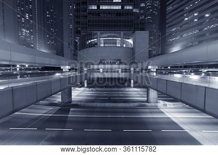 Exterior Of Modern Office Building In Midtown Of Hong Kong City At Night