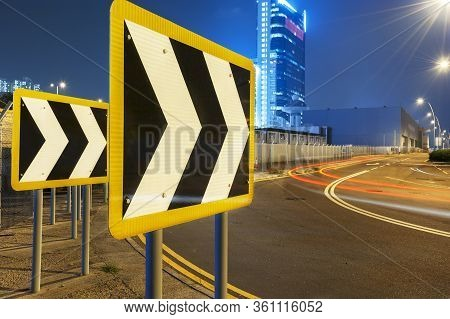 Arrow Sign And Light Trail On Road At Night