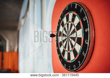 Dart Arrow Hitting In Bulls Eye On Dartboard.success Hitting Target Aim Goal Achievement Concept.ind