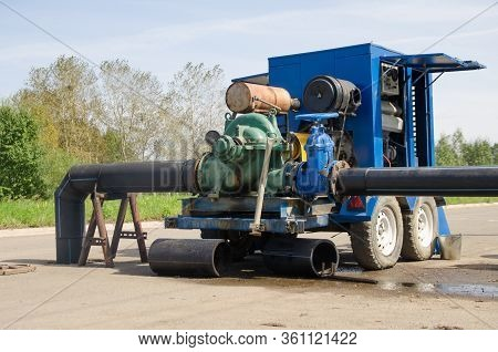 Industrial Sewer Pump Pumping Out Excess Water From The Sewer. Flooded Sewage Treatment.