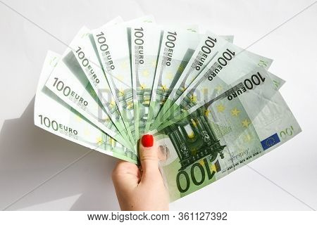 Euro Bills In Female Hands. Euro Cash Background On White, Fan Of 100 Euros, One Hundred Euros