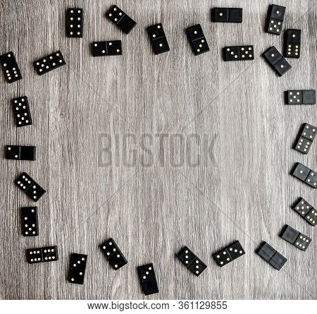 Frame Of Dominoes With Copy Space Inside On Wooden Background, Table Game, Black Domino Dice On A Li