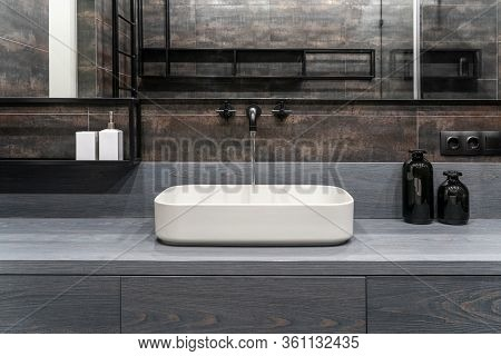 Interior Of Luminous Modern Bathroom With Bronze Walls