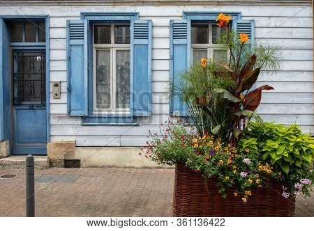 A Beautiful, Colorful Flower Bed In Front Of The Blue Facade Of The Troyes House. Aube, Champagne-ar