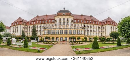 Sopot, Poland - July 23, 2019: The majestic Grand Hotel at Sopot on the Baltic Sea coast near Gdansk seen from the beach and park side, Poland.