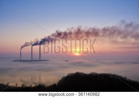 Colorful Blue And Pink Sky With Bright Rising Sun At Thermoelectric Power Plant. Thermal Chimneys Pr