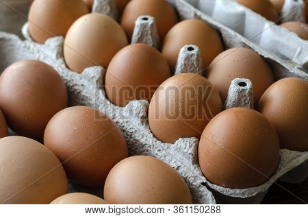 Brown Chicken Eggs In The Trays. Trays Of Raw Farm Eggs. Traditional Food. View From Above. Selectiv