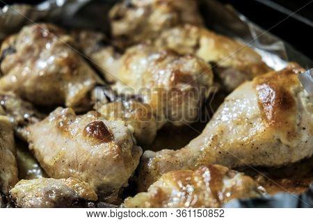 Golden Chicken Legs In Batter Fried In A Pan