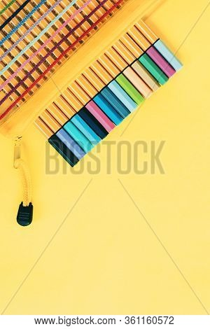 Set Of Capillary Pens In Pastel Colors. School Supplies On Yellow Background Back To School Concept.
