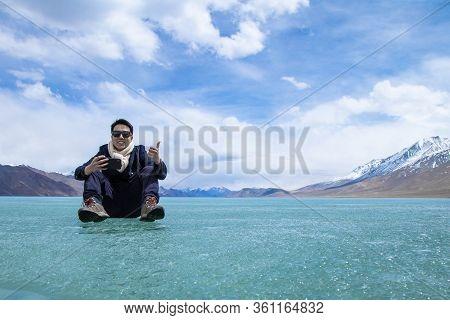 Man Stand Over Landscape Of Himalayas Mountains And Frozen Lake Pangong Tso High Grassland Lake Whil