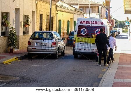 Torrevieja, Valenciana, Spain - Apr 12 2020 : Ambulance Taking Ill Patient To Hospital During Covid-