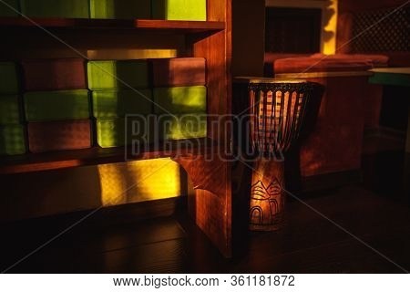 Multi-colored Wall Of The Room With An Abstract Pattern And Yellow Highlights And Shadows. Percussio