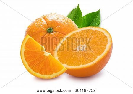 Closeup Of Isolated One Half And Quarter Of Fresh Orange Fruit With Water Droplets And Green Leaves