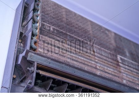 Old Air Conditioner And Focus Evaporator Of Dirty, Foul, Be Putrid Before Cleaning On The Purple Wal