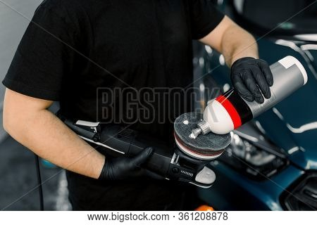 Cropped Image Of Hands Of Male Auto Service Worker, Putting Special Polish Wax Or Cream On The Orbit