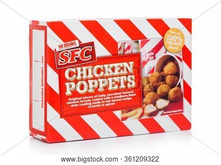 London, Uk - April 01, 2020: Box Of Chicken Poppers With Southern Fried Style Coating On White.