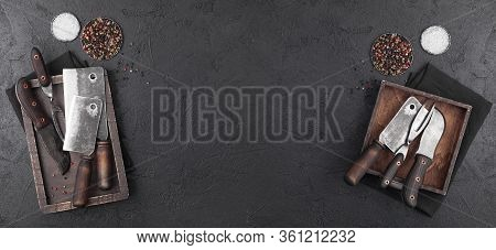 Vintage Wooden Boxes With Meat Hatchets And Fork With Knife On Black Background With Salt And Pepper