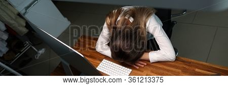 Top View Of Tired Businesslady In Office. Businesswoman Sleeping After Hard-working Day At Workplace