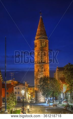 Bell Tower Of The Cathedral In Caorle, Veneto, Italia At Night. Hdr Image. Long Exposure Time.