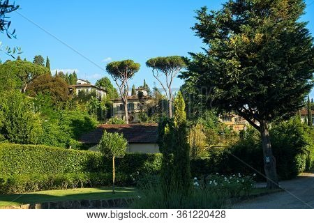 A Picturesque Neighborhood In Florence Italy: Handsome Villas, Lush Gardens, And Uniquely Shaped Tre
