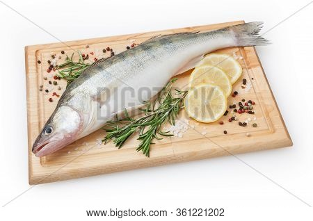 Fresh Uncooked Pike Perch With Lemon, Rosemary And Spice On Wooden Board Isolated On White Backgroun