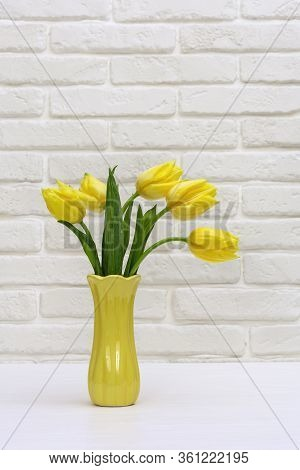 Bouquet Of Yellow Flowers Tulip In Small Ceramic Vase On White Background. Natural Spring Flowers In