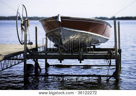 Fishin Boat on Boat Lift in Lake