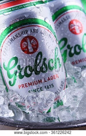 Cans Of Grolsch Beer In Bucket With Crushed Ice