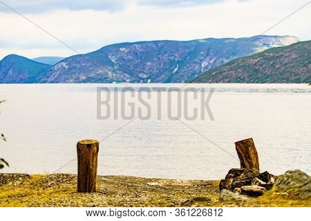 Bonfire And Fjord Landscape Near Erdal Village In Norway, Scandinavia Europe. Tourism Vacation And T