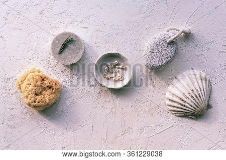Beauty Capsules, Natural Soap, Sea Sponge And Pumice Stone On White Plaster Background. Natural Orga