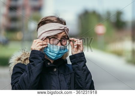 Woman With Facemask And Tarnished Glasses, Corona Concept