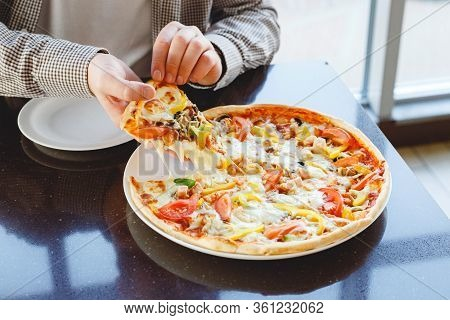 Eating Pizza At Home. Delicious Pizza Delivery. Caucasian Man Take Piece Of Delicious Italian Pizza