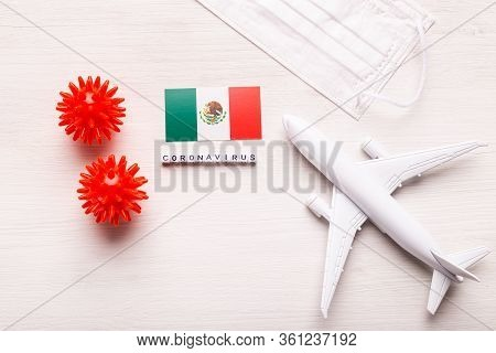 Plane Model And Face Mask And Flag Mexico. Coronavirus Pandemic. Flight Ban And Closed Borders For T