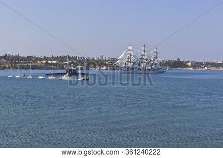 Sevastopol, Crimea, Russia - July 28, 2019: Sailboat Khersones Enters The Sevastopol Bay At The Para
