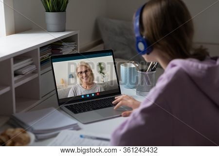 Distant Lesson With Middle-aged Teacher Using Video Conference Application