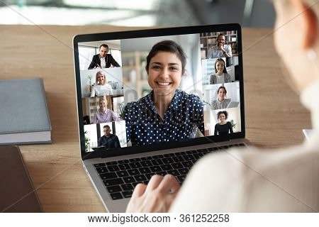 Laptop Screen Over Woman Shoulder View During Group Online Communication