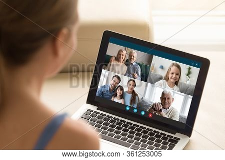 Woman Communicating With Family Using Laptop And Videoconference Application