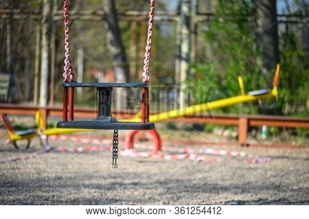 Chisinau, Moldova - April 04, 2020: Empty children playground in residential area during quarantine by reason of coronavirus AKA covid-19 virus threat. State of emergency declared in Moldova from