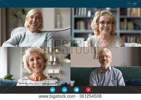 Four Seniors People Involved At Group Videocall Laptop Webcam View