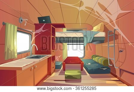 Abandoned Camping Trailer Car Interior With Loft Bed, Ragged Couch, Kitchen Sink, Desk With Laptop,
