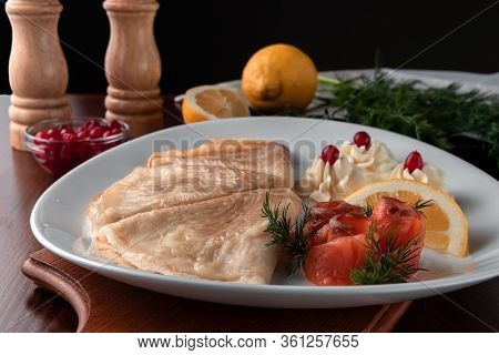 Delicious Pancakes With Red Fish, Lemon And Cranberries On A White Plate, Table Served In Restaurant