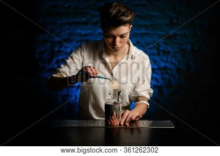 Woman Bartender Accurate Decorates Figured Glass With Ice By Slice Of Citrus Using Tweezers And Look