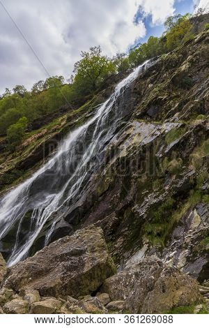 Panoramic View Of The Powerscourt Waterfall, Irelands Highest Waterfall At The Foothills Of The Wick