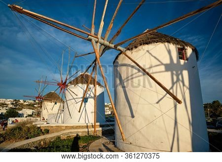 Scenic view of famous Mykonos Chora town windmills. Traditional greek windmills on Mykonos island at sunrise. Cyclades, Greece