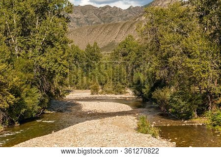 River Bottom. Altai Mountains, Are A Mountain Range In Central And East Asia, Where Russia, China, M