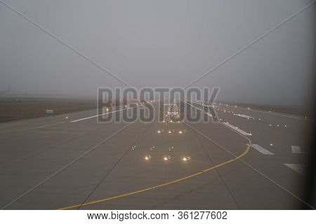 Airport Runway In The Evening With Lights. Runway, Airstrip In The Airport Terminal