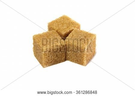 Cane Sugar Isolated On A White Background. Brown Whole Cane Sugar. Cubes Of Cane Sugar