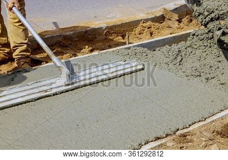 Construction Filling Formwork With Cement And Gravel Worker Pour Cement For Sidewalk In Concrete Wor